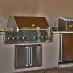 outdoor kitchen with grill, fridge and sink